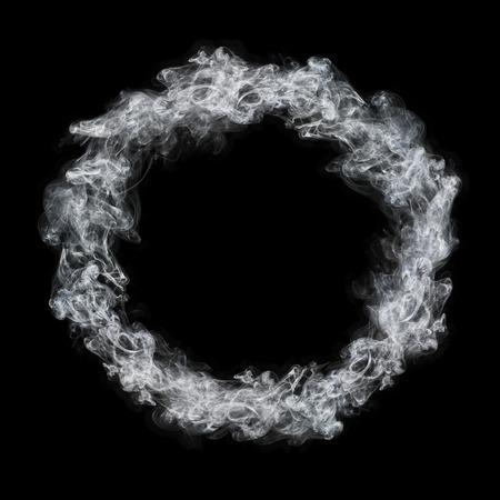 it is circle white smoke frame isolated on black. Фото со стока