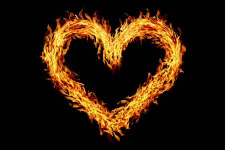 it is heart shaped burning fire isolated on black.