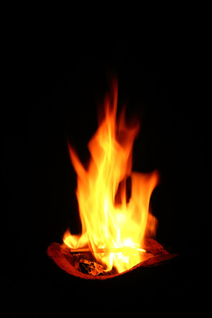 it is burning firewood with fire in stove. Stock Photo