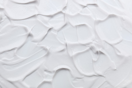 grease paint: it is white cream texture for pattern and background. Stock Photo