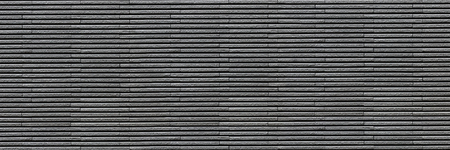 horizontal dark gray modern brick wall for pattern and background.