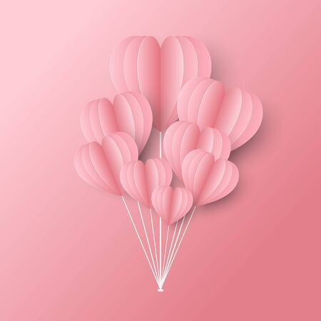 group of sweet pink heart shaped balloons on pink background.
