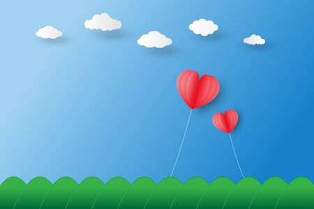 two red heart shaped balloons  float on blue sky under white clouds and over mountain. Ilustração