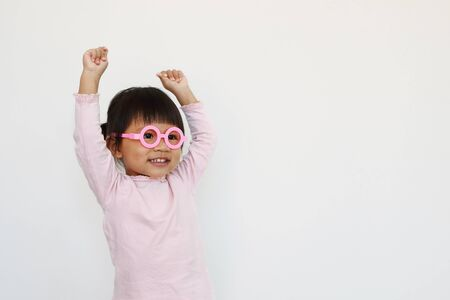 happy smiling asian girl wears glasses and hand up.
