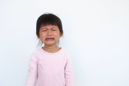 one naughty asian kid is crying. Imagens