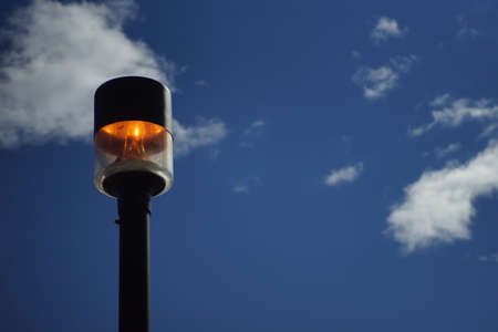 lit lamp: Lit lamp post with orange fiery glow