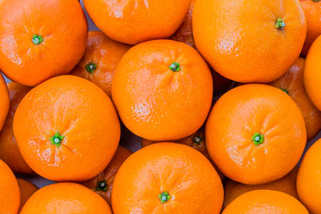 clementines: Closeup of clementines stacked in a pile Stock Photo