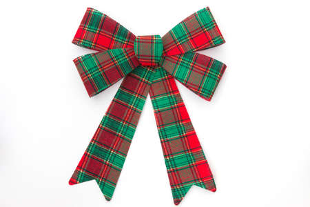 Red and green plaid holiday bow on white background Banco de Imagens