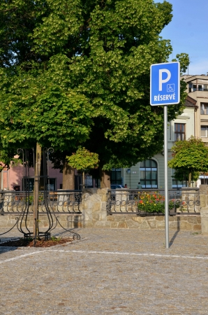car care center: Parking place reserved only for disabled persons