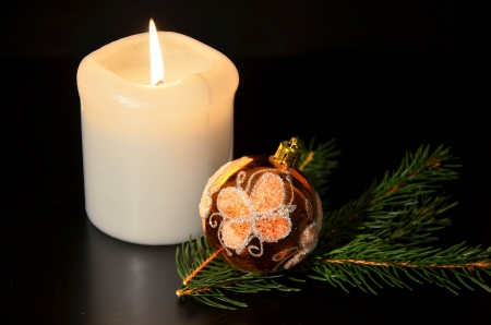 Christmas decoration with twig of spruce on the black photo