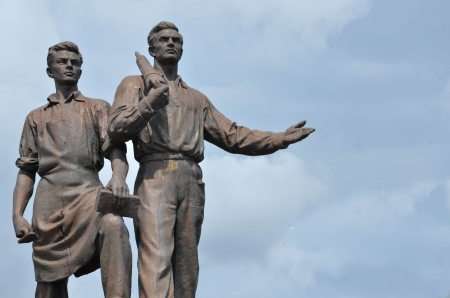 Old statue of two labours from epoch of socialism  Stock Photo