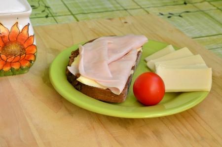 Tasty breakfast - slice of bread, ham and cheese photo