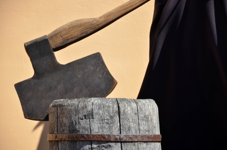 inquisition: Headsmans axe hewed in old wooden chunk Stock Photo