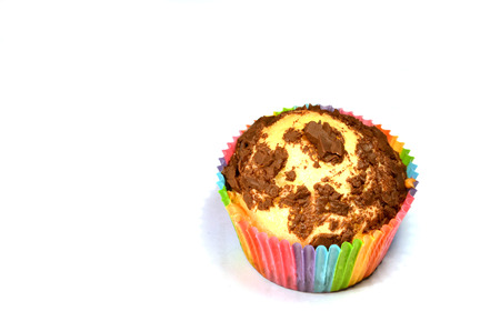 paper basket: Chocolate muffin in colorful paper basket Stock Photo