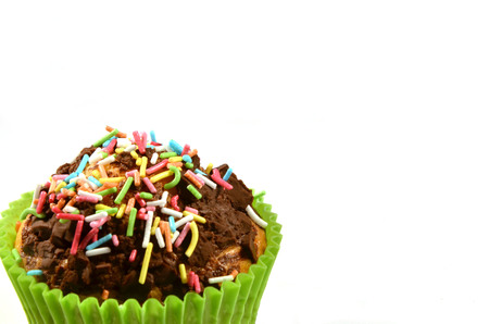 paper basket: Chocolate muffin in colorful paper basket isolated on white background