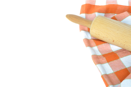 dishcloth: Orange white checkered dishcloth and rolling pin isolated on white