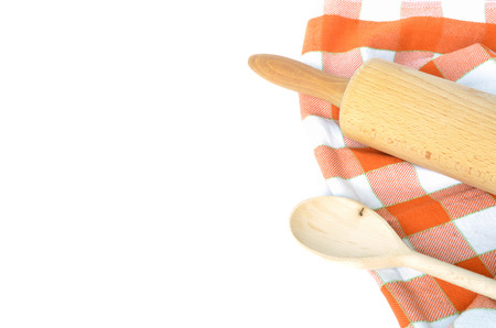 dishcloth: Checkered dishcloth, wooden rolling pin and spoon isolated on white