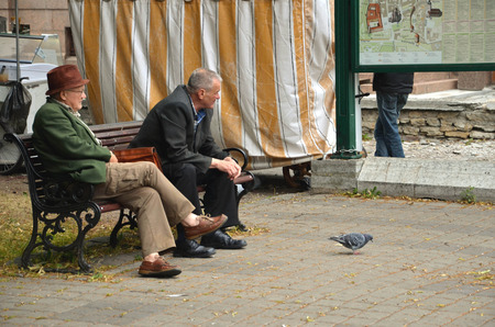 oldage: TALLINN  ESTONIA - July 27, 2013: Two old-age pensioners seated on the public bench