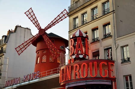 scandalous: PARIS  FRANCE - September 24, 2011: Moulin Rouge (Red Mill), the world famous cabaret in Paris, one of the most popular tourist attraction in the city.