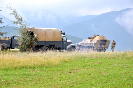 Strecno, Slovakia - July 21, 2012: Historical reenactment of World War 2 battle - armored transport vehicle  and soldiers dressed in german nazi uniforms