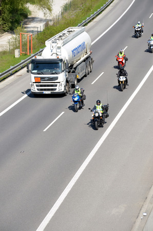 d1: Dolny Hricov, Slovakia - April 30, 2016: Cistern truck preceded by group of motorbikers on slovak D1 highway Editorial