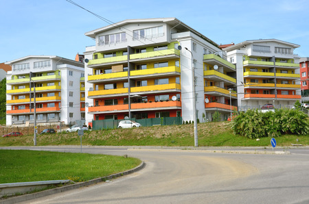 dwelling: Zilina, Slovakia - June 4, 2016: Group of coloured apartment dwelling houses next to the public route