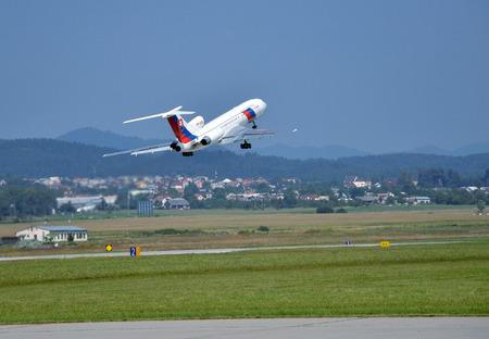 Sliac, Slovakia - August 27, 2011: Tupolev Tu-154 airplane of Slovak Government Flying Service takes off from runway Editorial