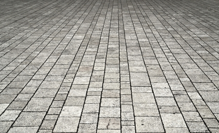 the pavement: background or texture with lumps of stone tiles