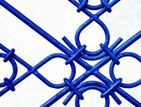 background or texture of hammer forged steel grid blue photo