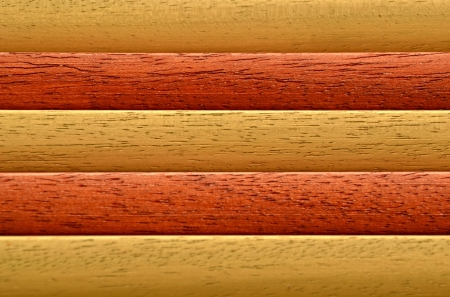laths: background with laths of hardwood orange and reddish brown Stock Photo