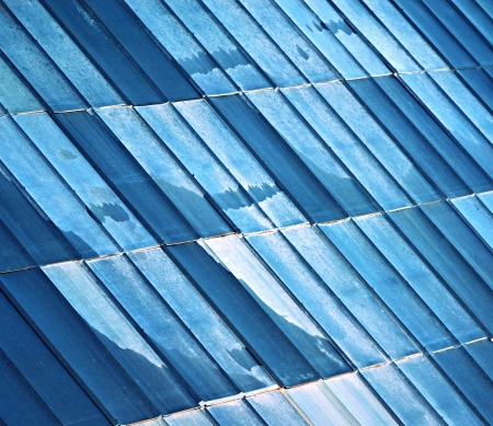 old metal tiled roof blue white color Stock Photo