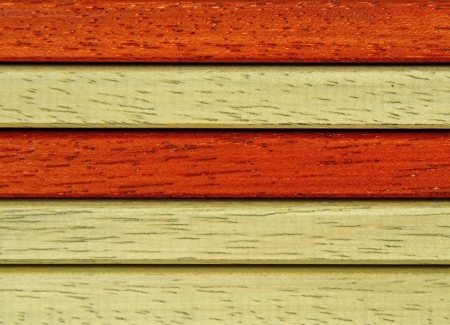 background with laths of hardwood orange and reddish brown Stock Photo