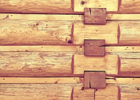 background or texture of a wooden log cabin wall photo