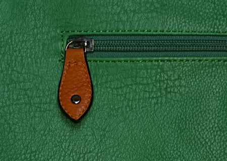 background or texture zipper on a emerald green bag photo