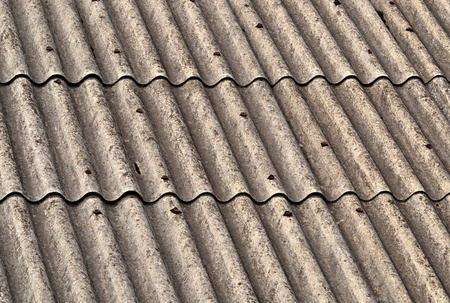 background or texture old gray wavy eternit roof