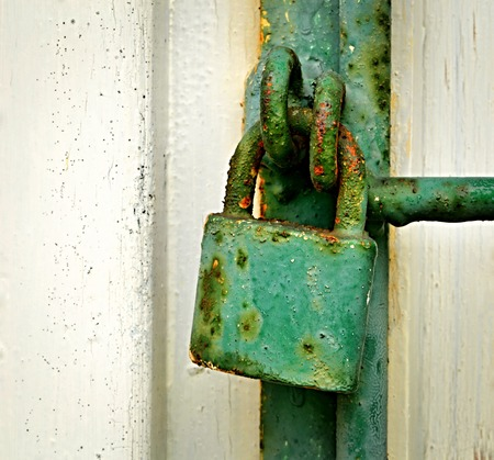 background with old green rusty iron padlock photo