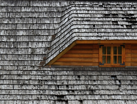 background or texture Old roof on a wooden cottage photo