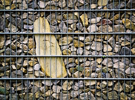 background or texture imprisoned in stone steel mesh