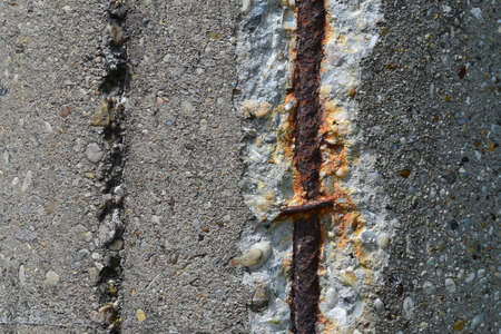 foundation cracks: abstract background or texture rusty steel rebars in old concrete Stock Photo