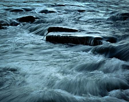 grim dark blue wild river Stock Photo