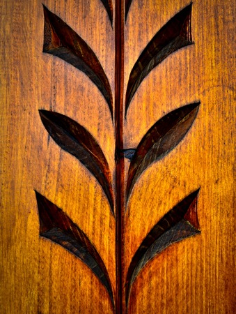 traditional folk art carved pattern on wood