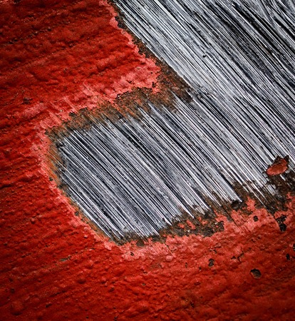 abstract background or texture red sanded paint on steel