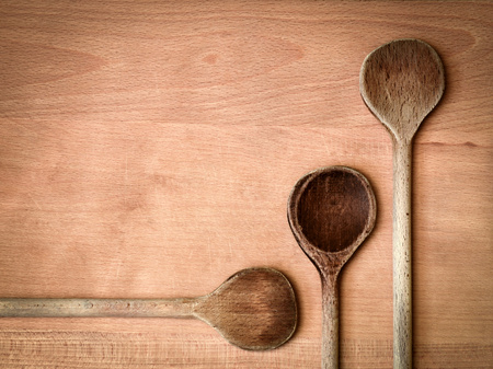 abstract kitchen background Three old wooden spoon