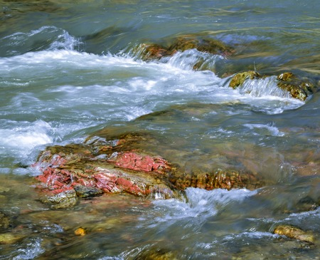 abstract background or nature scene red stone in a wild river photo