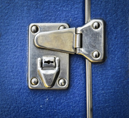 abstract background or texture metal lock on a blue suitcase