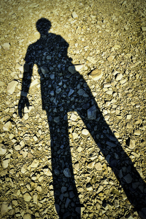 abstract background shadow figures standing on a stone beach