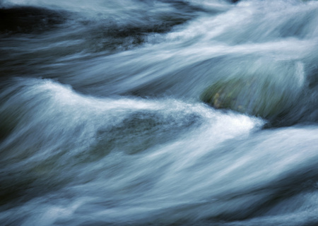 sombre: abstract sombre background or texture  fierce rapids on the river