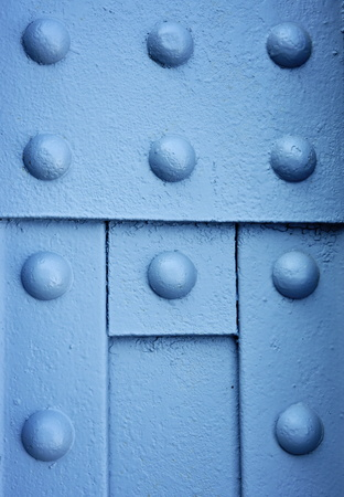rivets: background or texture blue Round iron rivets on the beam