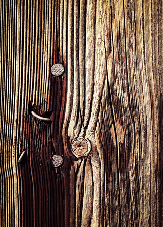 rusty nail: abstract background or texture rusty nail in old wooden board