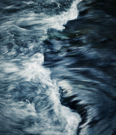 rapids: abstract dark background detail on the rapids of the river